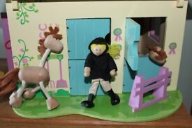 elc wooden horse stable with two horses and a jockey