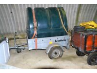 Water tank and trailer