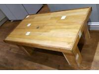 Coffee table made from reclaimed maple skittle alley planks