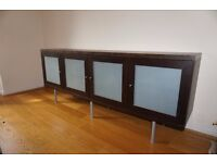 Wood dining room cabinet with frosted glass doors and glass shelves