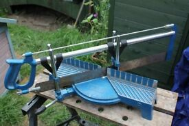 Mitre Saw (for cutting wood at a required angle)