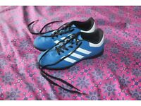 Boys size 2 blue and white adidas football trainers.