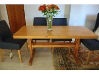 6 seater pine dining table and 2 matching chairs