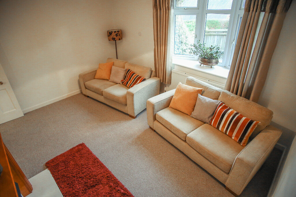 A pair of M & S two seater sofas in vgc