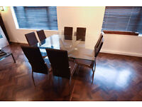 8 seater square glass top dinning table and 8 high backed chairs - Like new