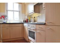 A spacious apartment in a secure development moments from Stepney Green.