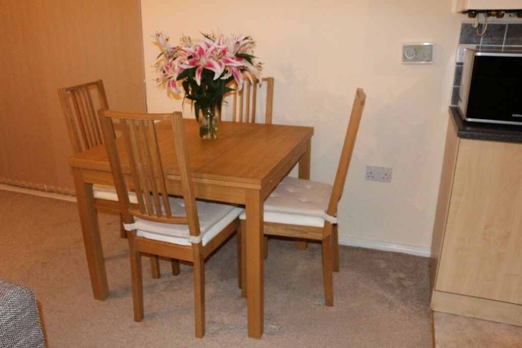 Extending Dining Table and with 4 Chairs oak veneer BJURSTA