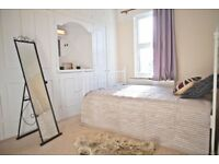 A Huge Double Bedroom with LOTS OF STORAGE in a cosy friendly share, available NOW