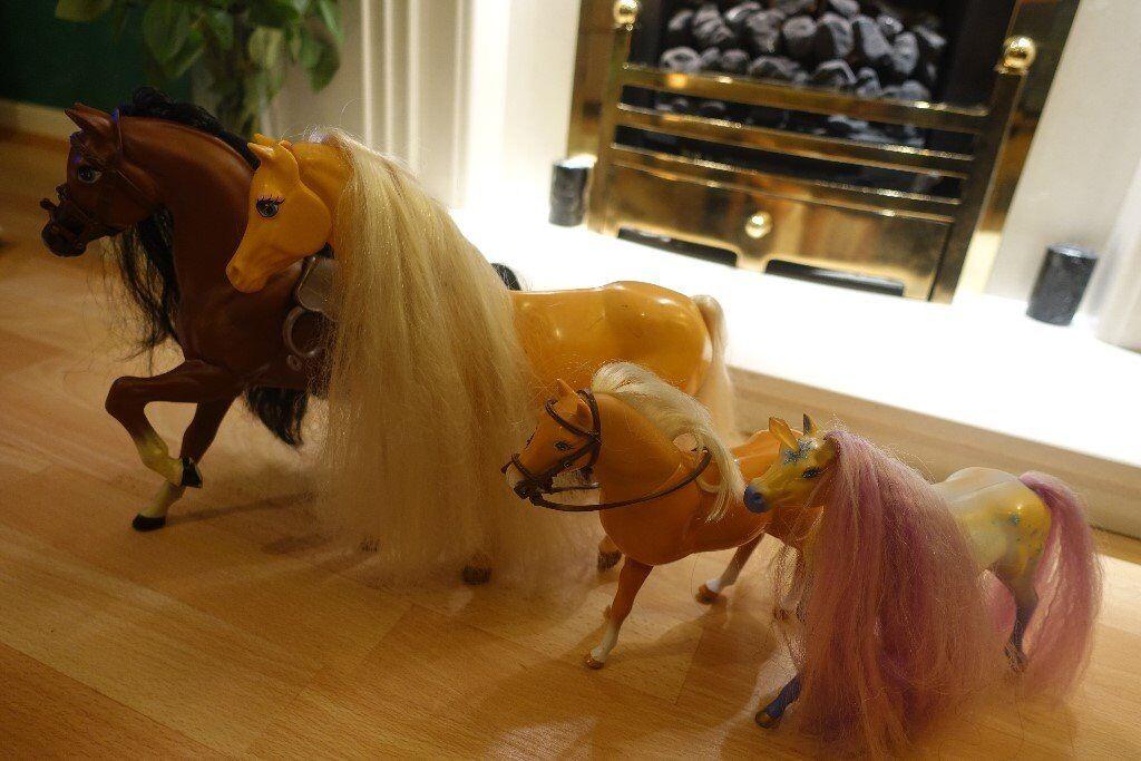 Three toy horses and an Unicorn