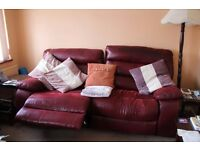 Reclining three seater sofa in leather type material