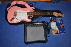 Guitar in pink with amplifier