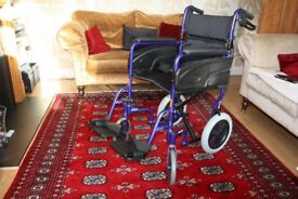 Folding lightweight travel wheelchair with handbrake