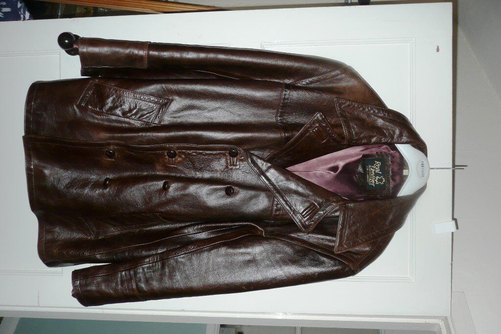 Genuinely vintage glossy tan double breasted leather jacket, size 44, from 1980s