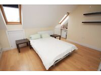A spacious double with ensuite located close to zone 2 station and shops