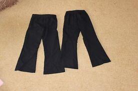 2 pairs of girls elasiticated navy trousers (aged 6)