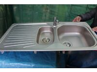 Frank linear stainless steal kitchen sink and mixer taps.