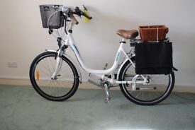Dutch-style electric bike under 100 miles with paniers, car-horn and mirror. Offers.