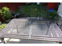 Extendable garden table and 8 chairs - needs some TLC