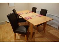 Wooden expandable table + four chairs eco-leather. Almost new!