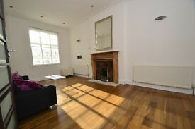 A bright, high ceilinged two bedroom apartment located within a well serviced apartment building.
