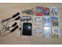 Wii with 7 games, 2 controllers, nunchucks, and 2 wheels