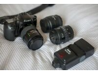 Minolta Dynax 500si w/ case, flash, and three lenses