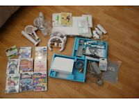 Nintendo Wii including fitness Board, Games and Many Extras