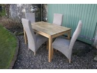 Solid Oak dining table and four upholstered chairs for sale