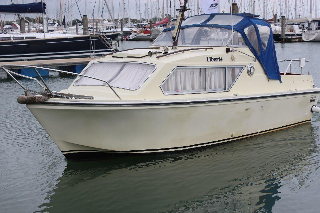 classic cabin cruiser motor boat in lymington hampshire