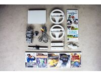 Nintendo Wii Console, 2 controllers, 2 Steering wheels, 1 nunchuck, 7 Games.