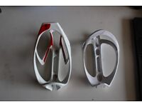 2 x bottle cages 1 specialized 1 btwin
