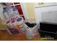 childs garden swing chair,plastic ride on car,princes kitchen,monitor,and bags of mixed items