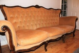 Antique Sofa with carved legs and back