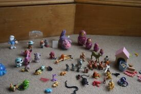 Bundle of little live pets, digibird, robofish, wooden & plastic animals, Russian dolls, etc.
