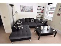 Sofology Napier Tower corner sofa and cuddler swivel chair charcoal grey black