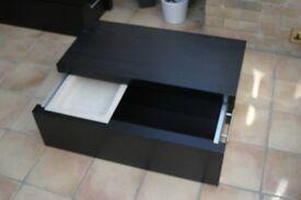 Black IKEA storage box with sliding lid and tray.
