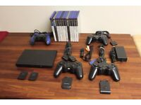PlayStation 2 (PS2) with 12 games plus 4 controllers (2 PS2 wireless controllers)
