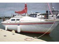 Yacht: Jaguar 24 twin bilge keel sailing cruiser. Boat ready to sail. Seen afloat at Poole.