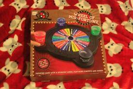 Wheel of misfortune drinking board game