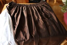 A pair of John Lewis chocolate brown lined silk curtains.