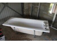 Fibreglass white bath with taps