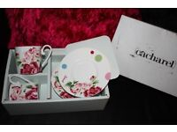 Cacharel Bone China Cup and Saucer Set