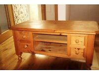 Solid wood coffee table, has been adapted to house TV with DVD/video etc.