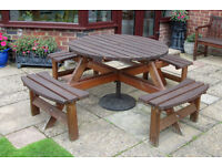 Round garden table with seats.