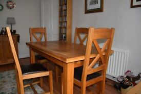 Fenwicks Oak Dining Table with 4 Chairs .