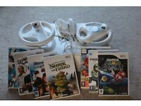 SOLD Wii console with assorted bundle including games, Wii fit and X factor