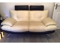 3 seater and 2 seater cream and black leather sofas with extendable headrests