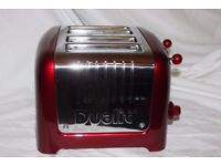 Boxed Dualit Lite 4 Slot Lite Toaster in Metallic Red combined with Used once. Looks Brand New