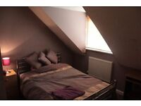 Modern room in quiet cul-de-sac just five minutes walk from Train station.