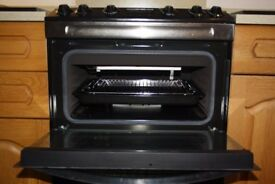 Zanussi black double conventional gas oven with grill less than 1yr old